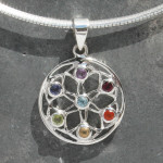 sterling silver Chakra Flower, Seed of Life Pendant contains a corresponding stone for each of the seven Chakras, starting at the Crown with Blue Topaz (centre of the Seed of Life) followed by: Amethyst, Iolite, Peridot, Citrine, Carnelian and Garnet at the Root Chakra.
