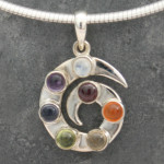 Chakra Spiral Pendant with Garnet , Carnelian , Citrine, Peridot, Iolite, Amethyst and Moonstone .