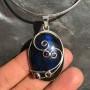 Oval Labradorite pendant wire design with garnet iolite peridot